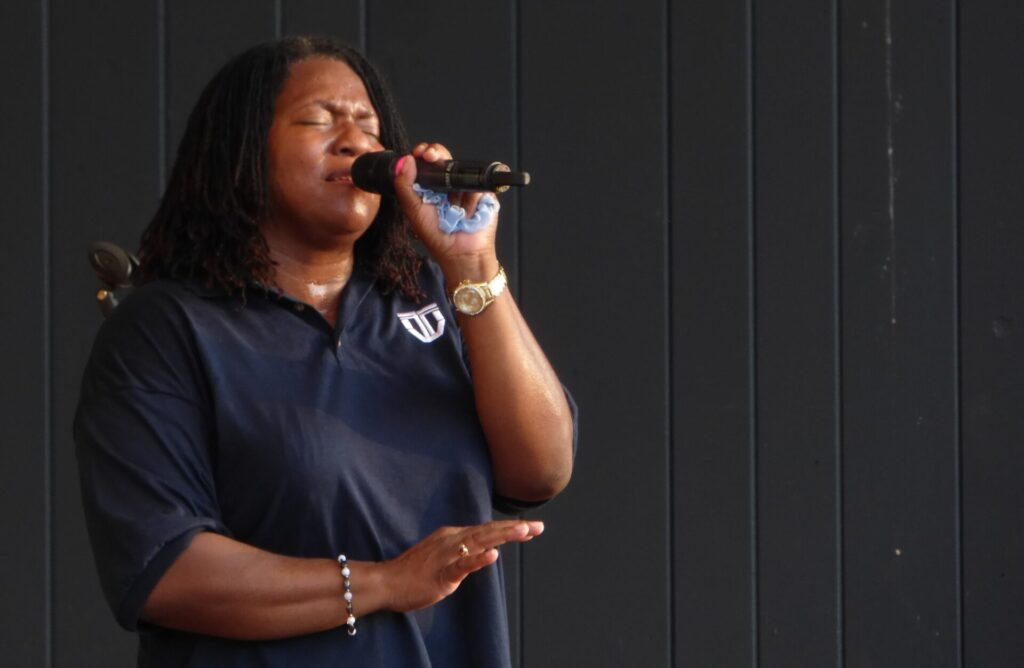 """Singer Troia Butcher performs at """"A Day of Healing"""" at Longs Park on Thursday, Aug. 12, 2021. (Photo: Tim Stuhldreher)"""