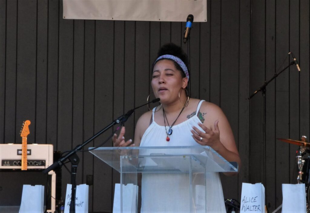 """Evita Colon performs a spoken-word piece at """"A Day of Healing"""" at Longs Park on Thursday, Aug. 12, 2021. (Photo: Tim Stuhldreher)"""