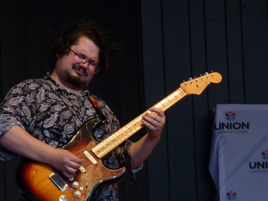 """Anthony Pieruccini plays guitar at """"A Day of Healing"""" at Longs Park on Thursday, Aug. 12, 2021. (Photo: Tim Stuhldreher)"""