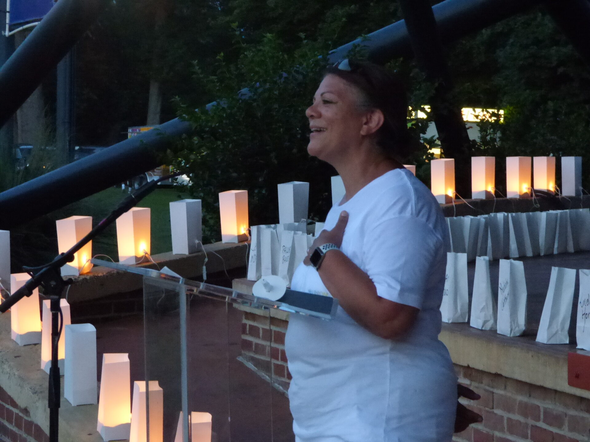 """Jackie Concepcion, Vice President of Community Impact, Union Community Care, thanks the crowd at the conclusion of """"A Day of Healing"""" at Longs Park on Thursday, Aug. 12, 2021. (Photo: Tim Stuhldreher)"""