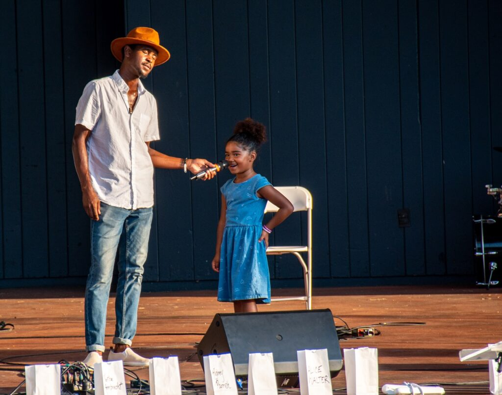 """Ty Gant and his daughter, Milan, perform at """"A Day of Healing"""" at Longs Park on Thursday, Aug. 12, 2021. (Photo: Kevin Ressler)"""