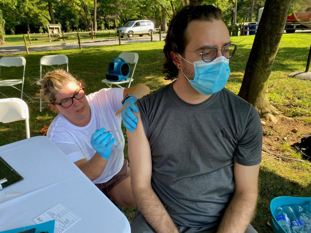 """Marylouise Deaven, of Union Community Care, administers a Covid-19 vaccine during A Day of Healing"""" at Longs Park on Thursday, Aug. 12, 2021. (Photo: Provided)"""