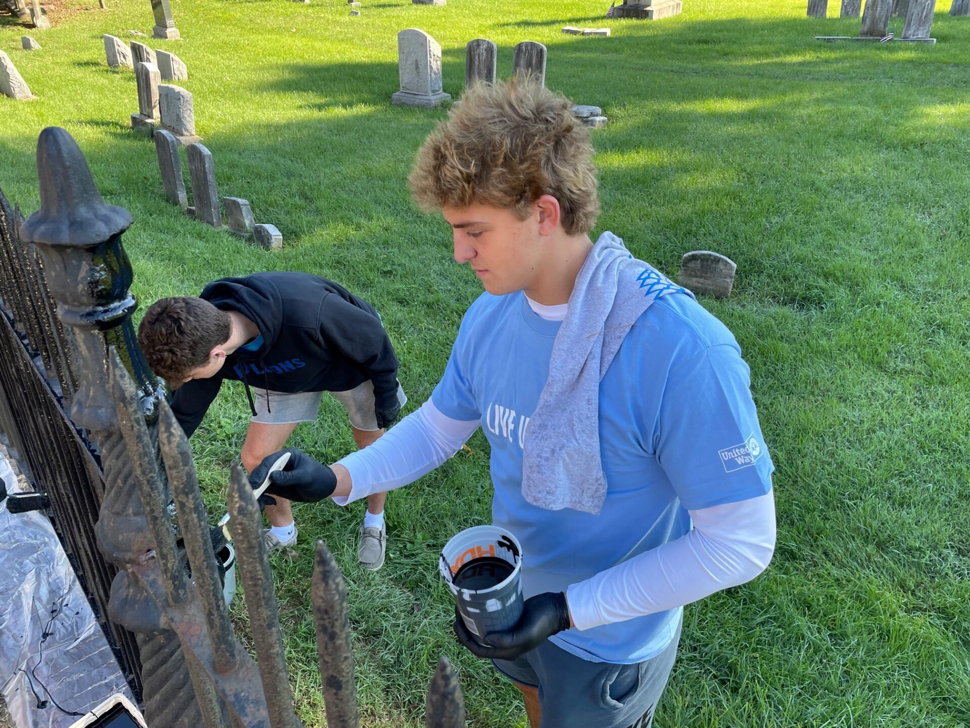 Millersville University students repaint the fence at Lancaster Cemetery as part of the United Way of Lancaster County on Saturday, Sept. 11, 2021. (Photo: Kyle Gamble)