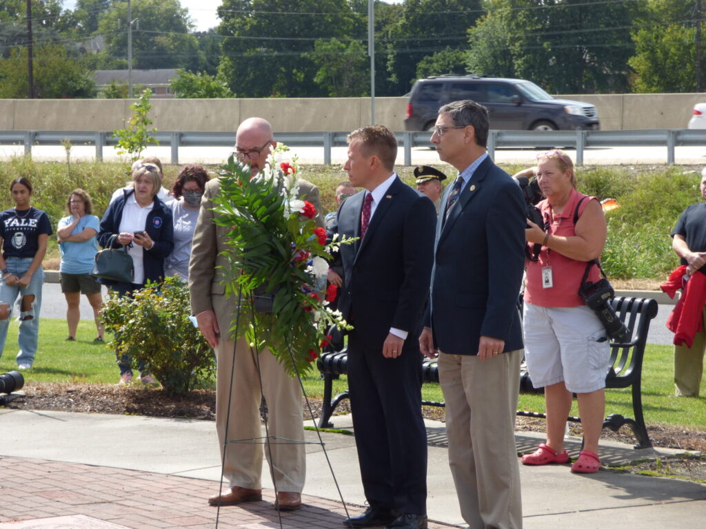 County Commissioners Craig Lehman, Josh Parsons and Ray D'Agostino prepare to place a wreath at the memorial to first responders outside the Lancaster County Public Safety Training Center on Friday, Sept. 10, 2021. (Photo: Tim Stuhldreher)