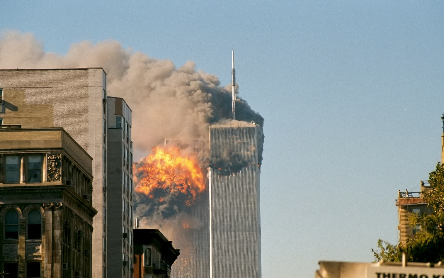 Flames billow as United Airlines Flight 175 crashes into the south tower of the World Trace Center on Tuesday, Sept. 11, 2001. (Source: Wikimedia Commons)