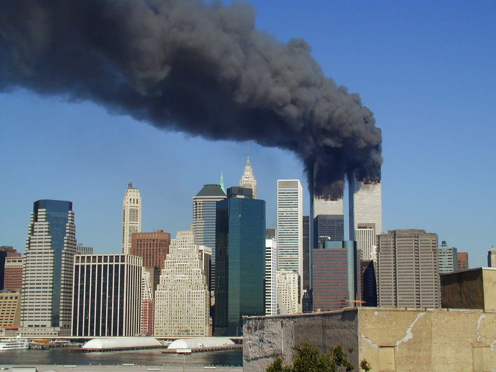 Smoke pours from the World Trade Center towers in New York City following the terrorist attacks on Sept. 11, 2001. (Source: Wikimedia Commons)
